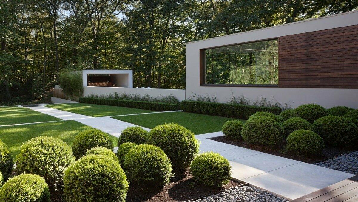Элементы ландшафтного дизайна: оформление ландшафта декором из дерева, объемные деревянные фигуры